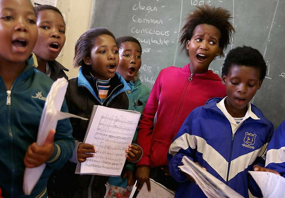 QUNU, SOUTH AFRICA - APRIL 03:  Children ages five to seven practice singing at the Qunu Junior Secondary School April 2, 2013 in Qunu, South Africa. Former South African President Nelson Mandela lived in Qunu from age two to nine and it was here that he began school at a Methodist missonary school just steps away from the current school building. In his autobiography Mandela recalled that he was the first in his family to attend school and that his teacher assigned him the English name Nelson there. Mandela was admitted to the hospital with pneumonia last week, although officials say his condition is improving.  (Photo by Chip Somodevilla/Getty Images) *** BESTPIX *** Photo: Chip Somodevilla, Getty Images