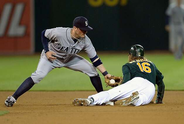 OAKLAND, CA - APRIL 03:  Josh Reddick #16 of the Oakland Athletics steals second base ahead of the tag by Brendan Ryan #26 of the Seattle Mariners in the eighth inning at O.co Coliseum on April 3, 2013 in Oakland, California. The Athletics won the game 6-2. (Photo by Thearon W. Henderson/Getty Images) Photo: Mike McGinnis, Getty Images