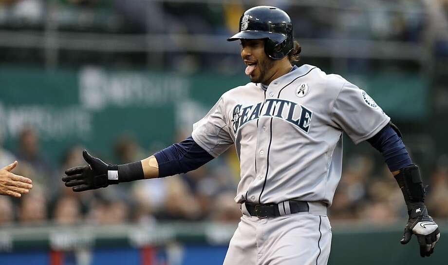 Seattle Mariners' Michael Morse celebrates after hitting a home run off Oakland Athletics' Tommy Milone in the first inning of a baseball game on Wednesday, April 3, 2013, in Oakland, Calif. (AP Photo/Ben Margot) Photo: Ben Margot, Associated Press