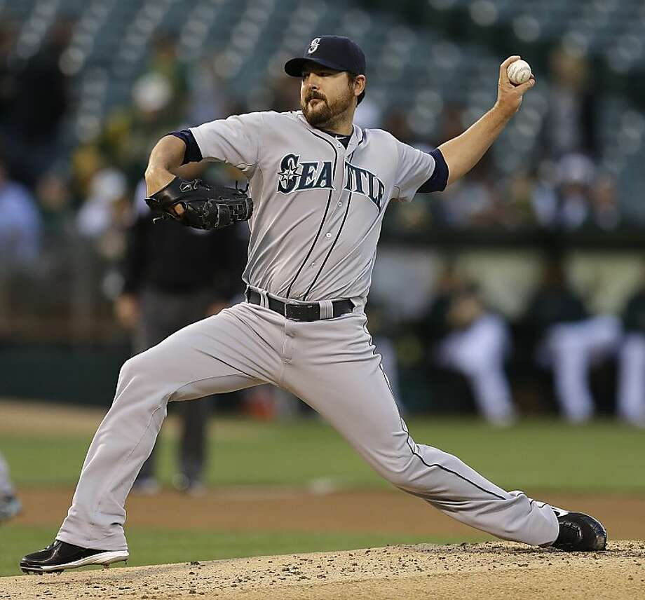 Seattle Mariners' Joe Saunders works against the Oakland Athletics in the first inning of a baseball game on Wednesday, April 3, 2013, in Oakland, Calif. (AP Photo/Ben Margot) Photo: Ben Margot, Associated Press