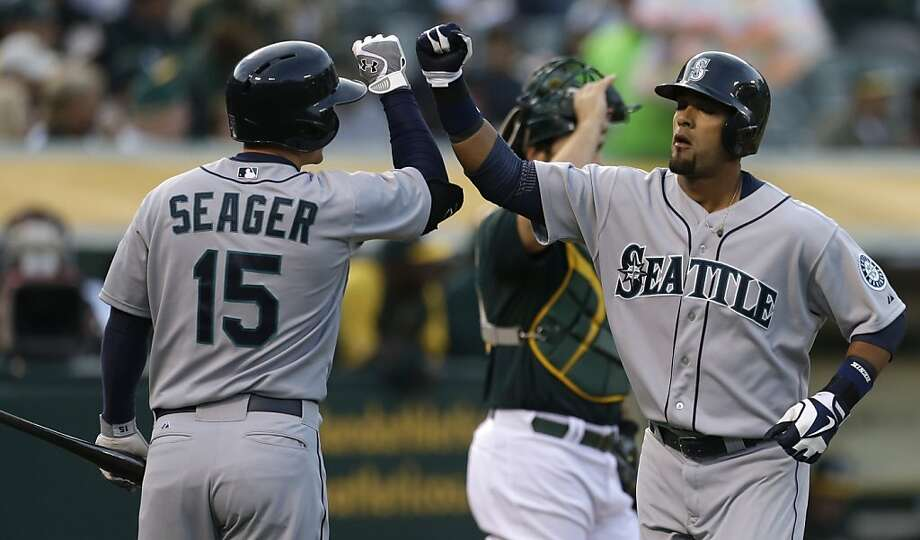 Seattle Mariners' Franklin Gutierrez, right, is congratulated by teammate Kyle Seager (15) after hitting a home run off Oakland Athletics' Tommy Milone in the first inning of a baseball game on Wednesday, April 3, 2013, in Oakland, Calif. (AP Photo/Ben Margot) Photo: Ben Margot, Associated Press