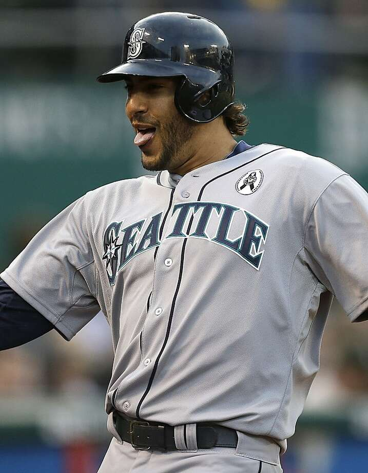 Seattle Mariners' Michael Morse celebrates after hitting a home run off Oakland Athletics' Tommy Milone in the first inning of a baseball game Wednesday, April 3, 2013, in Oakland, Calif. (AP Photo/Ben Margot) Photo: Ben Margot, Associated Press