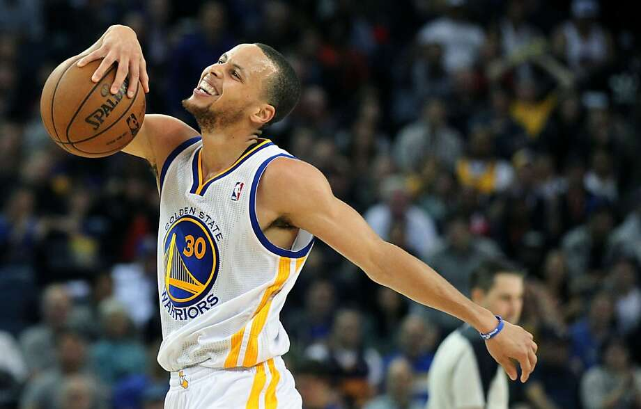 Golden State Warriors guard Stephen Curry (30) reacts after being called on a foul against New Orleans Hornets guard Greivis Vasquez (21) in the first half of their NBA basketball game Wednesday, April 3, 2013 in Oakland, Calif. Photo: Lance Iversen, The Chronicle