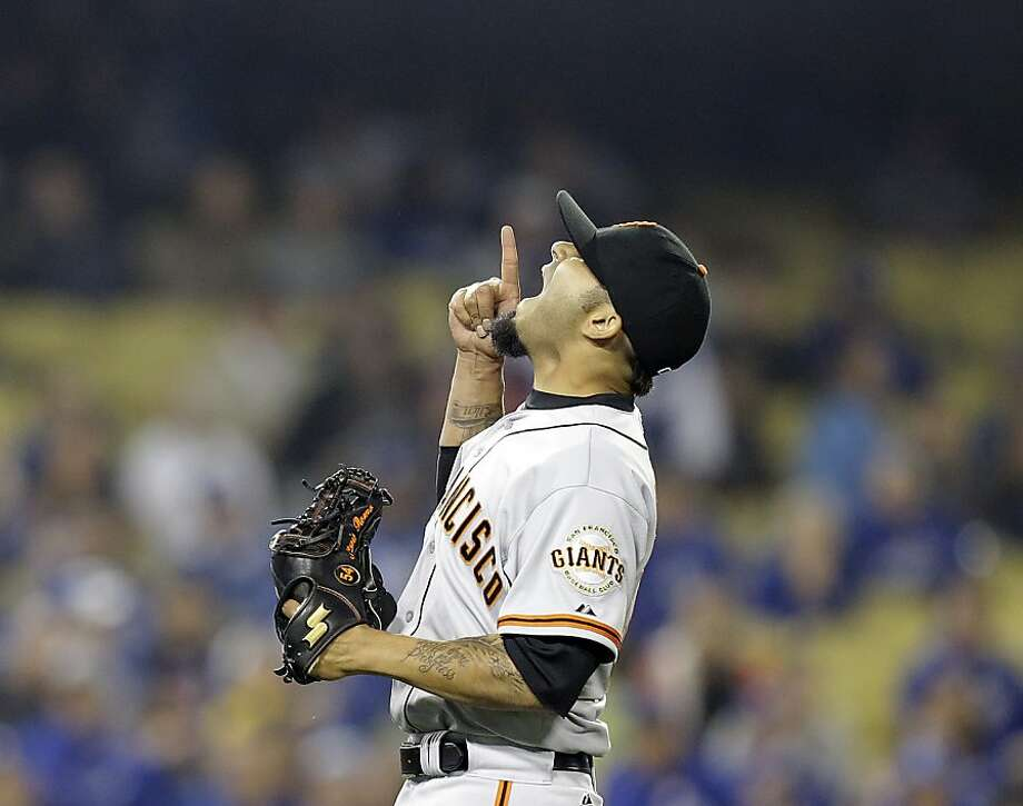 San Francisco Giants reliever Sergio Romo celebrates after getting the final out in the Giants 5-3 win voer the Los Angeles Dodgers in a baseball game in Los Angeles Wednesday, April 3, 2013.  The Giants won, 5-3. (AP Photo/Reed Saxon) Photo: Reed Saxon, Associated Press