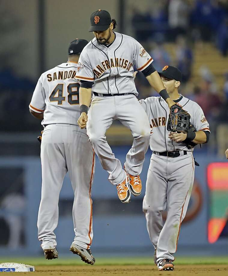San Francisco Giants including centerfielder Angel Pagan, center, celebrate their 5-3 win voer the Los Angeles Dodgers in a baseball game in Los Angeles Wednesday, April 3, 2013. (AP Photo/Reed Saxon) Photo: Reed Saxon, Associated Press