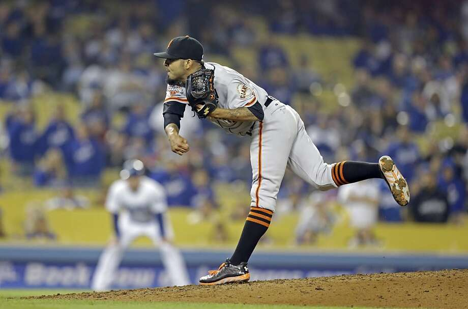 San Francisco Giants reliever Sergio Romo works the ninth inning against the Los Angeles Dodgers in a baseball game in Los Angeles Wednesday, April 3, 2013.  The Giants won, 5-3. (AP Photo/Reed Saxon) Photo: Reed Saxon, Associated Press
