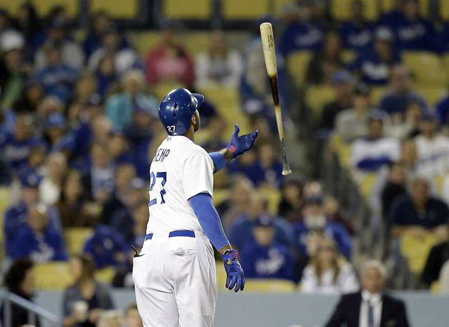 Los Angeles Dodgers' Matt Kemp tosses his bat after striking out to retire the side against the San Francisco Giants in the eighth inning of a baseball game in Los Angeles Wednesday, April 3, 2013. (AP Photo/Reed Saxon) Photo: Reed Saxon, Associated Press