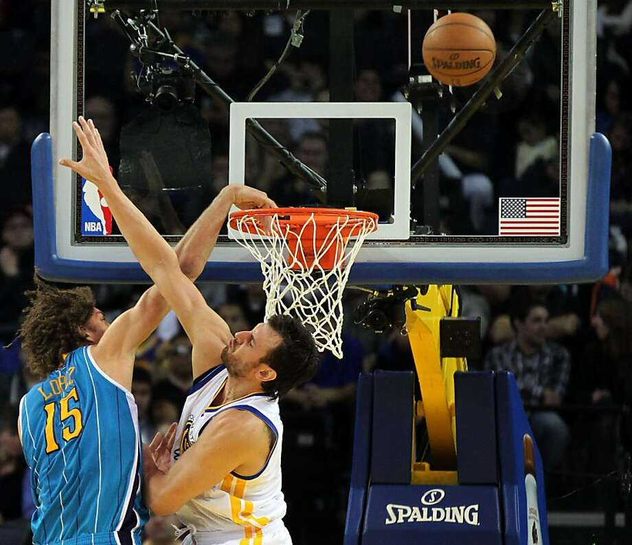 Warriors center Andrew Bogut makes his presence known to Hornets' Robin Lopez on Wednesday. Photo: Lance Iversen, The Chronicle