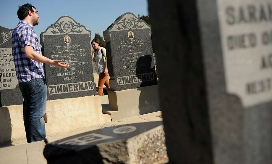 Robert Adler stands next to one of the many toppled headstones at the Mt. Zion Cemetary in East Los Angeles, California that have fell prey to vandalism.  (Wally Skalij/Los Angeles Times/MCT) Photo: Wally Skalij, McClatchy-Tribune News Service