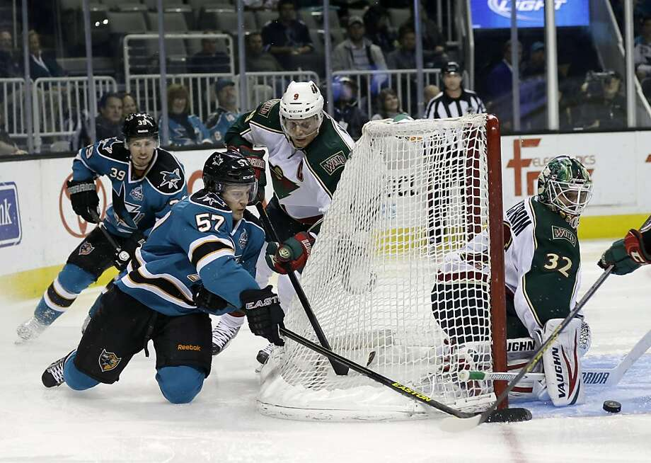 Minnesota Wild's Niklas Backstrom, of Finland, right, stops a shot attempt by San Jose Sharks center Tommy Wingels (57) during the third period of an NHL hockey game in San Jose, Calif., Wednesday, April 3, 2013. (AP Photo/Marcio Jose Sanchez) Photo: Marcio Jose Sanchez, Associated Press