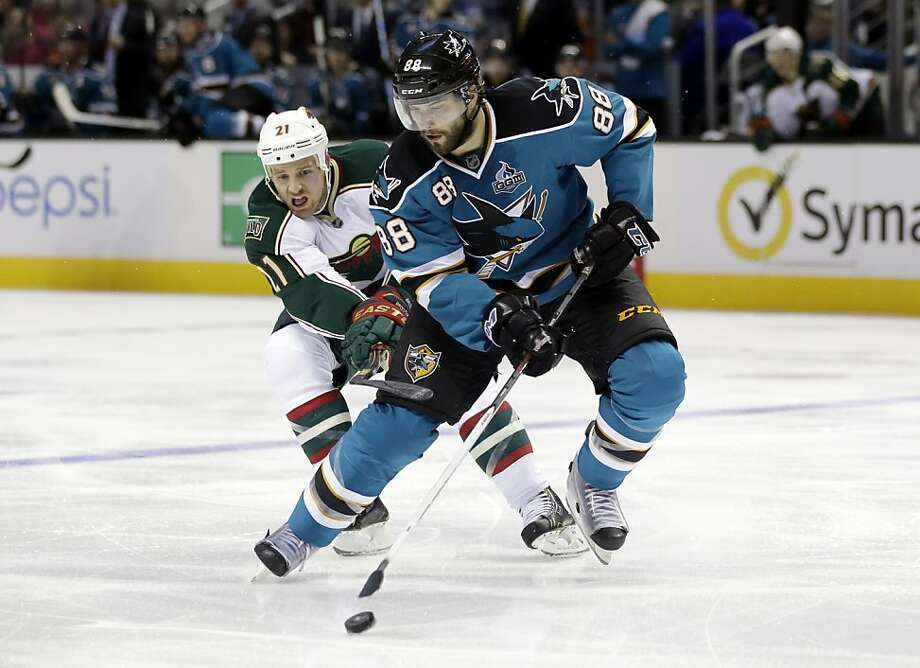 San Jose Sharks' Brent Burns (88) controls the puck next to Minnesota Wild's Kyle Brodziak (21) during the second period of an NHL hockey game in San Jose, Calif., Wednesday, April 3, 2013. (AP Photo/Marcio Jose Sanchez) Photo: Marcio Jose Sanchez, Associated Press