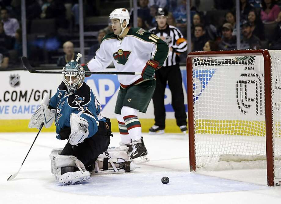 A shot by Minnesota Wild's Dany Heatley, not pictured, gets past San Jose Sharks goalie Antti Niemi, of Finland, left, as the Wild's Devin Setoguchi (10) reacts during the second period of an NHL hockey game in San Jose, Calif., Wednesday, April 3, 2013. (AP Photo/Marcio Jose Sanchez) Photo: Marcio Jose Sanchez, Associated Press