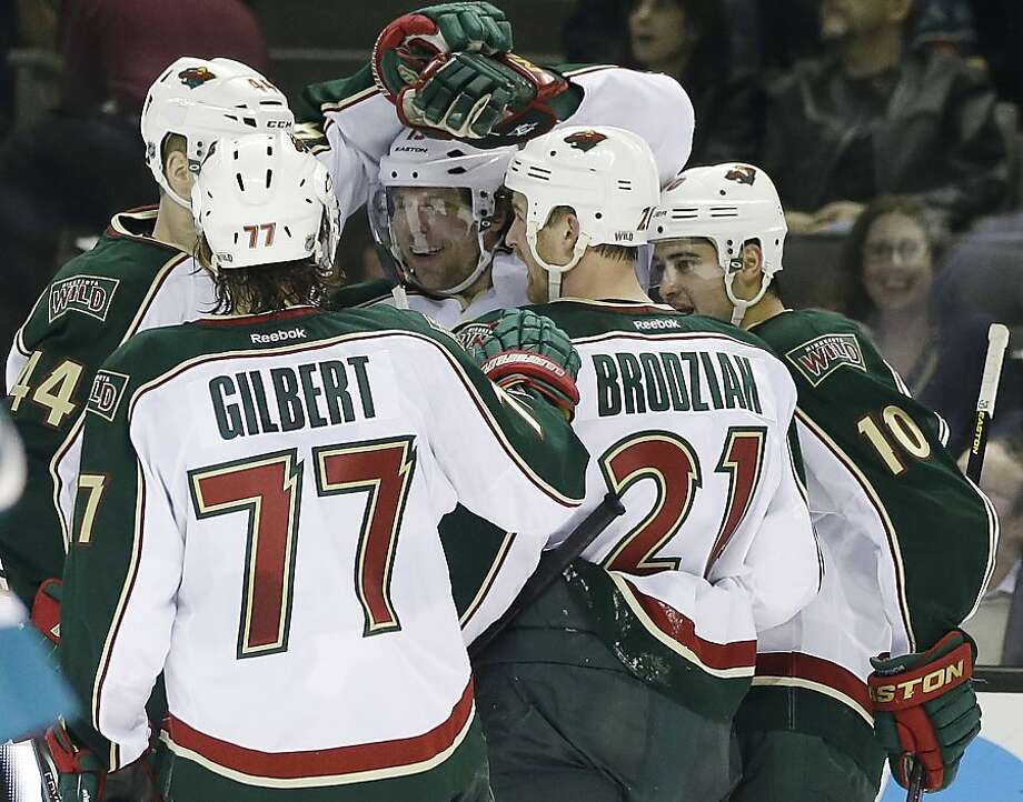 Minnesota Wild's Dany Heatley, center, celebrates his goal with teammates during the  second period of an NHL hockey game against the San Jose Sharks in San Jose, Calif., Wednesday, April 3, 2013. (AP Photo/Marcio Jose Sanchez) Photo: Marcio Jose Sanchez, Associated Press
