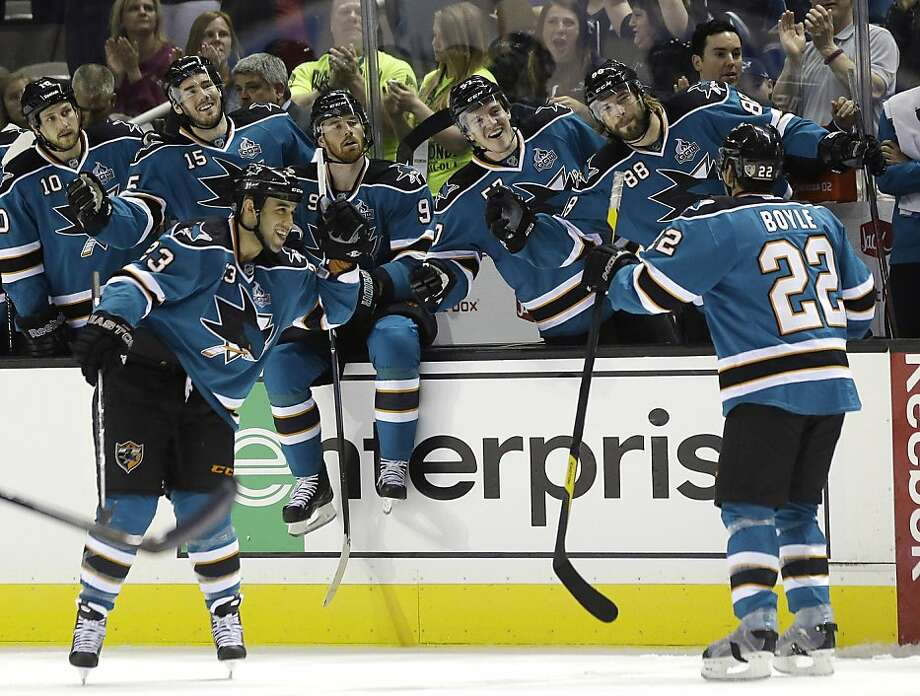 San Jose Sharks' Dan Boyle (22) celebrates his goal with teammates during the first period of an NHL hockey game against the Minnesota Wild in San Jose, Calif., Wednesday, April 3, 2013. (AP Photo/Marcio Jose Sanchez) Photo: Marcio Jose Sanchez, Associated Press