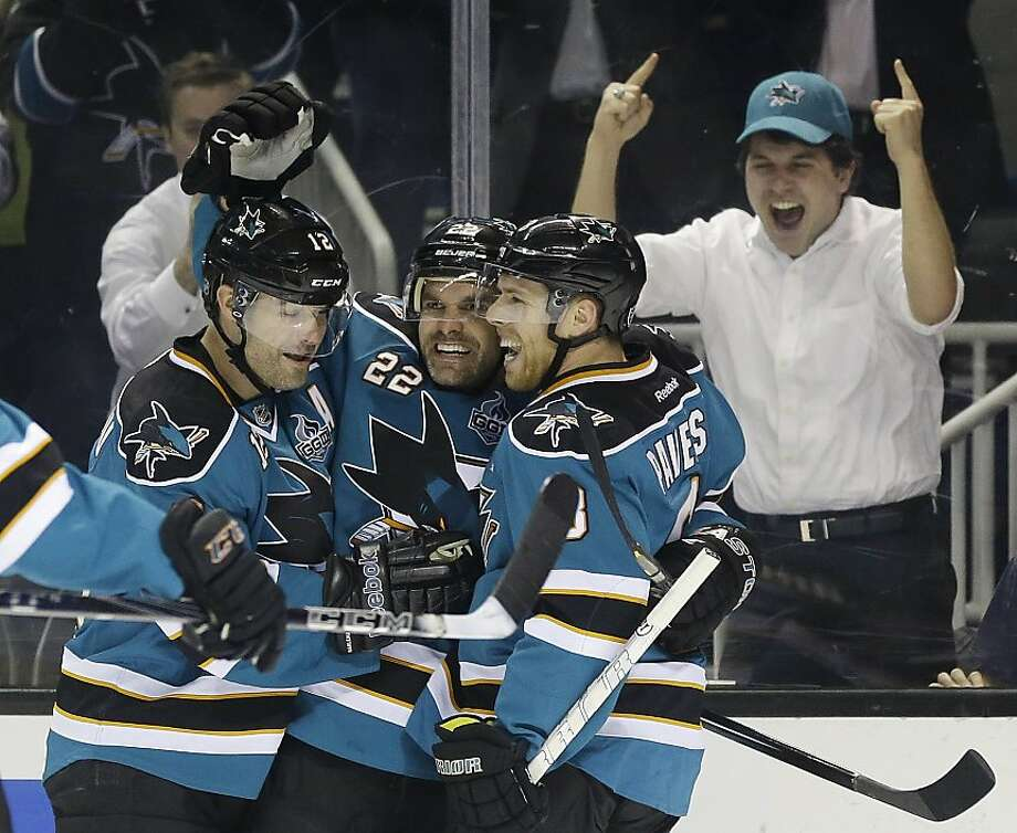 San Jose Sharks' Dan Boyle, center, celebrates his goal with teammates Joe Pavelski, right, and Patrick Marleau during the first period of an NHL hockey game against the Minnesota Wild in San Jose, Calif., Wednesday, April 3, 2013. (AP Photo/Marcio Jose Sanchez) Photo: Marcio Jose Sanchez, Associated Press