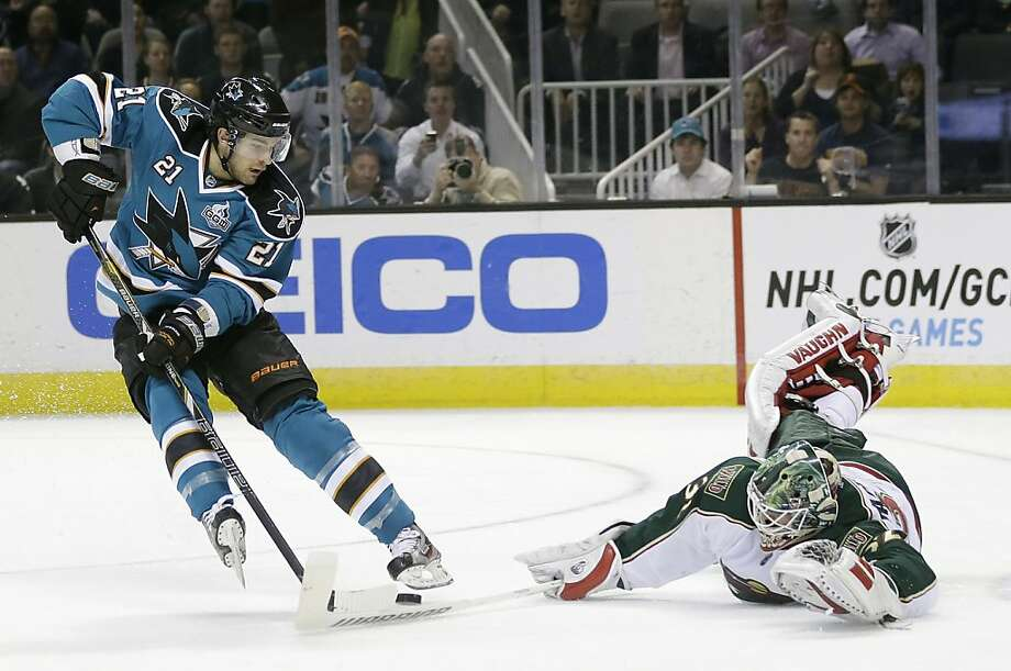 Minnesota Wild goalie Niklas Backstrom, right, of Finland, stops a shot attempt from San Jose Sharks' T.J. Galiardi (21) during the first period of an NHL hockey game in San Jose, Calif., Wednesday, April 3, 2013. (AP Photo/Marcio Jose Sanchez) Photo: Marcio Jose Sanchez, Associated Press