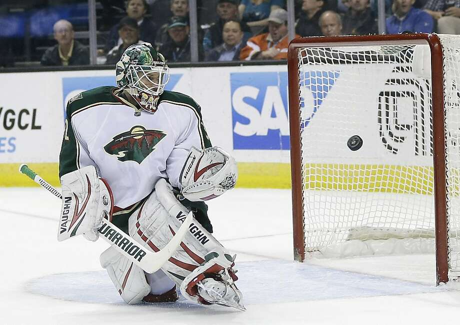 Minnesota Wild's Niklas Backstrom (32) deflects a shot on goal against the San Jose Sharks during the first period of an NHL hockey game in San Jose, Calif., Wednesday, April 3, 2013. (AP Photo/Marcio Jose Sanchez) Photo: Marcio Jose Sanchez, Associated Press