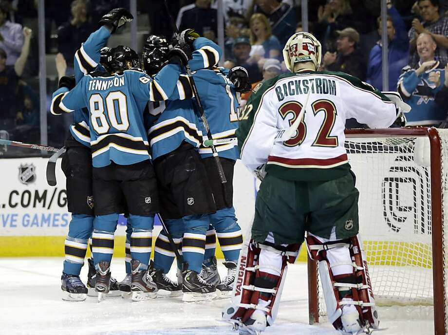 Minnesota Wild goalie Niklas Backstrom (32), of Finland, watches as the San Jose Sharks celebrate a goal by Martin Havlat during the first period of an NHL hockey game in San Jose, Calif., Wednesday, April 3, 2013. (AP Photo/Marcio Jose Sanchez) Photo: Marcio Jose Sanchez, Associated Press