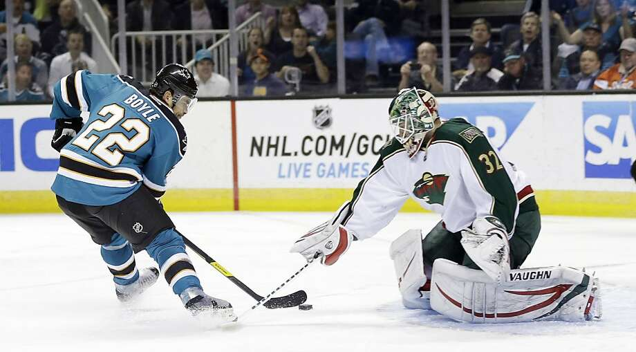 San Jose Sharks' Dan Boyle (22) scores past Minnesota Wild goalie Niklas Backstrom, of Finland, during the first period of an NHL hockey game in San Jose, Calif., Wednesday, April 3, 2013. (AP Photo/Marcio Jose Sanchez) Photo: Marcio Jose Sanchez, Associated Press