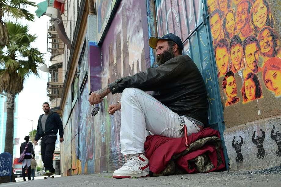 Damian Clarance Chapman, age 43, who is homeless, sits outside the Hugo Hotel on April 3, 2013 in San Francisco, Calif. An upcoming planning commission meeting will decide the fate of the historic Hugo Hotel. Photo: Sean Havey, The Chroncile / ONLINE_YES