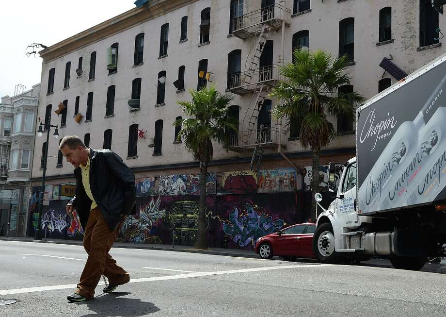 Howard Bronow, of San Francisco, age 63, walks past the Hugo Hotel on April 3, 2013 in San Francisco, Calif. An upcoming planning commission meeting will decide the fate of the historic Hugo Hotel. Photo: Sean Havey, The Chroncile / ONLINE_YES