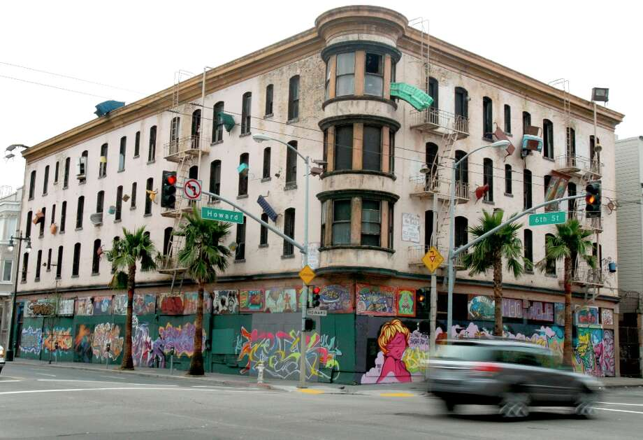 A motorist drives past the old Hugo Hotel, now known as the Defenestration Building, at Sixth and Howard Streets in San Francisco, Calif. on Saturday, Jan. 26, 2008. Photo: PAUL CHINN, SFC / The Chronicle