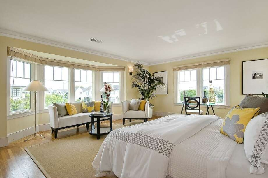 Windows spanning the walls fill the master suite with light.