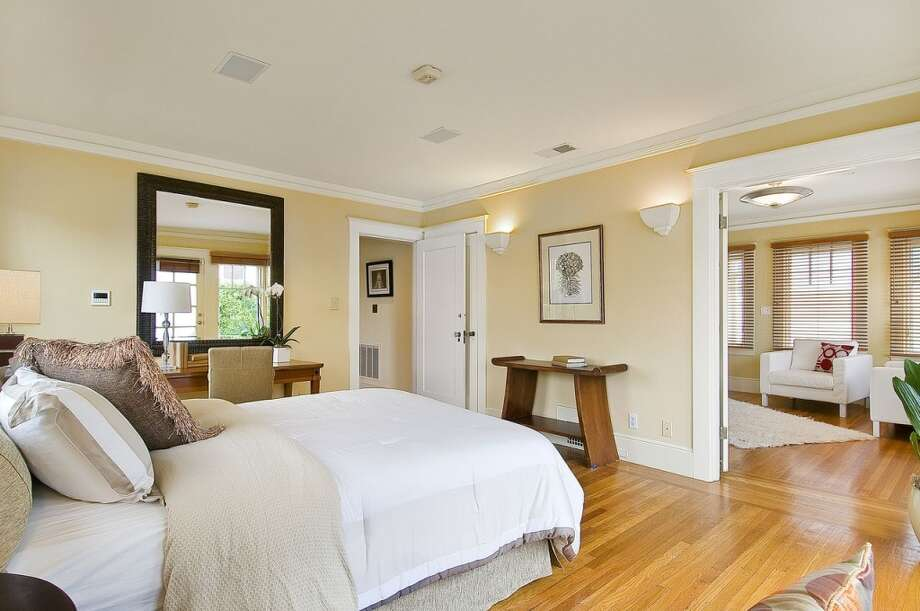 A guest bedroom connects to a seating area.