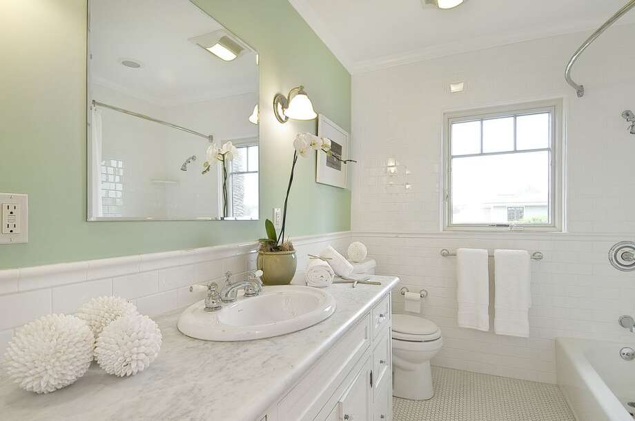 The bathrooms are finished in muted colors and whites, which make them feel light and open.