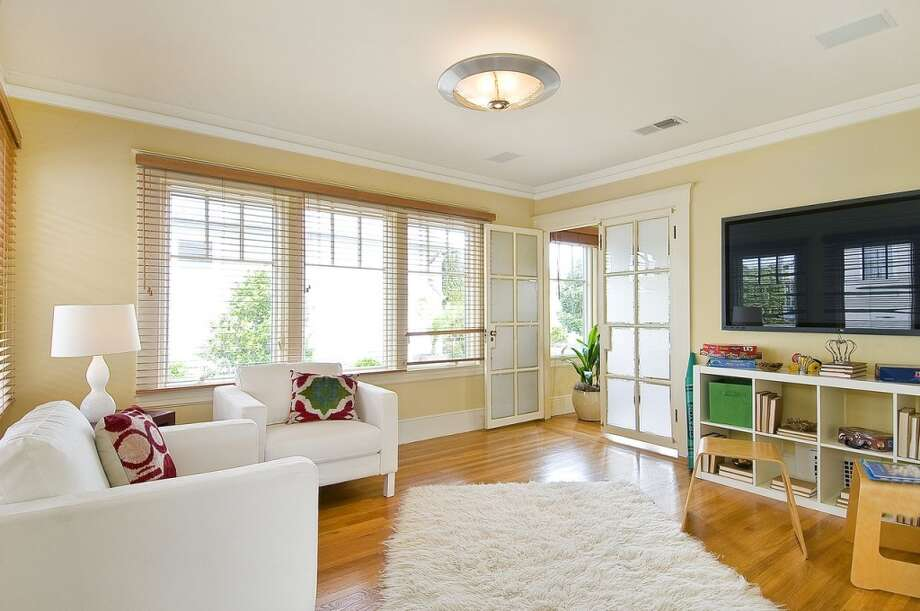 A seating area and playroom is located just off of the kids bedroom.