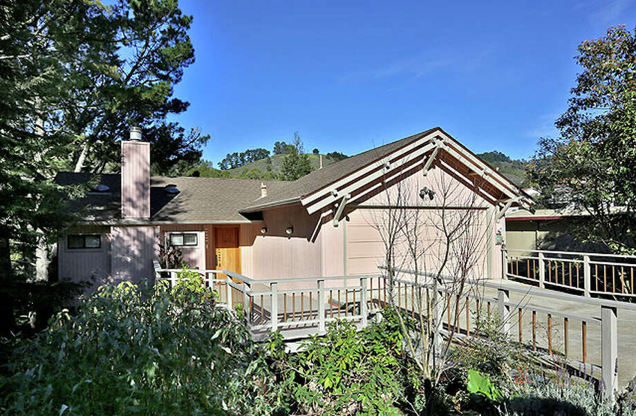 This private, three-story Berkeley hills home is on a quiet cul-de-sac location close to the Claremont Resort.