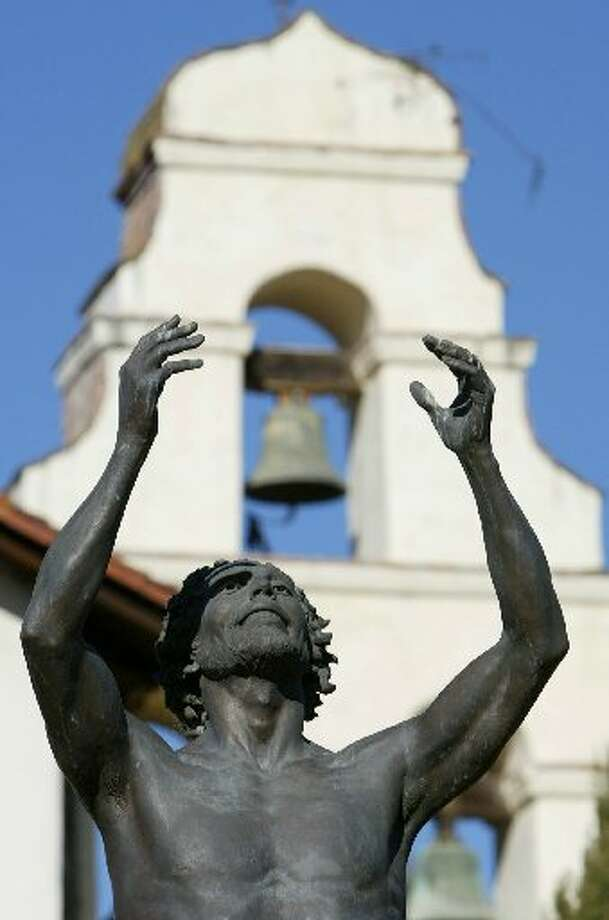SAN JUAN BAUTISTA: Sculptor Tom Marsh\'s statue of St. John the Baptist stands in front of Old Mission San Juan Bautista. The mission, founded in 1797 and located in the heart of the town, offers visitors the opportunity to experience Old California.  (Drive time: 1.5 hours hour)