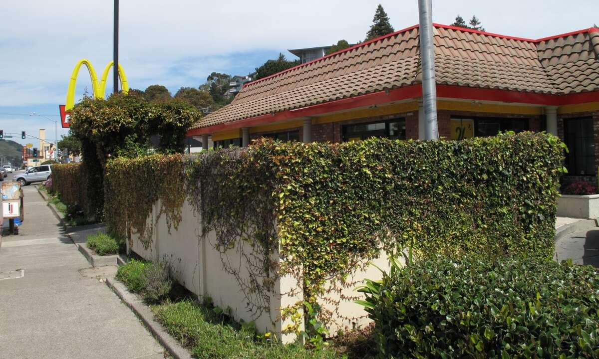 April 3, 2013: I have to give the owners credit. The railing has been replaced with a fortress-like wall, but the inside is still full of planter boxes and other flora. If you\'re going to have your rehearsal dinner at a McDonald\'s, this one off Highway 101 is difficult to beat.