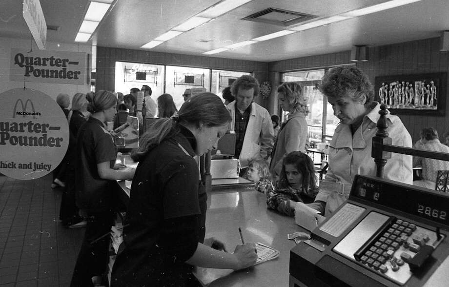 Feb. 27, 1973: I was surprised to see cashiers writing down their orders. Fast food was fully automated as long as I can remember. You\'ll notice in all of these photos how much slimmer the fast food patrons were in 1973. Either they ran around more, or didn\'t eat here every day. Photo: Stephanie Maze, The Chronicle / ONLINE_YES