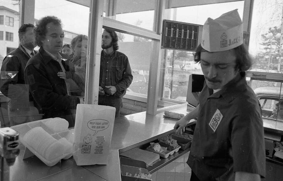 """Feb. 27, 1973: Pretty sure this guy was the inspiration for Judge Reinhold in \""""Fast Times at Ridgemont High.\"""" And pretty sure that\'s Abe Lincoln in the back right ordering a Jumbo Jack. I found the bag interesting, so I pulled in for a close-up on the next slide ... Photo: Stephanie Maze, The Chronicle / ONLINE_YES"""