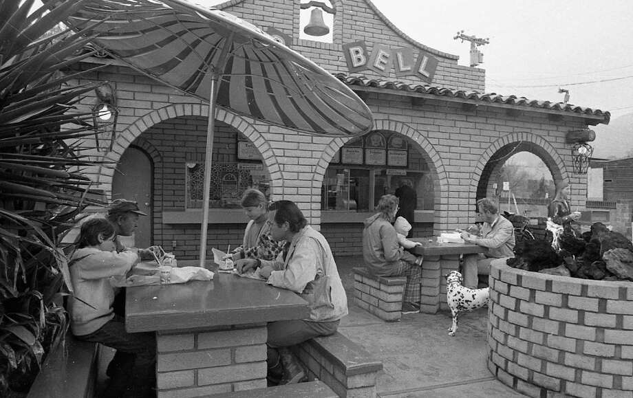 Feb. 27, 1973: The front of the Taco Bell in San Anselmo. That was some kind of rock sculpture/fire pit/virgin sacrifice alter in the center of the patio. I\'m glad younger generations can see this photo, so they don\'t think I\'m lying when I say Taco Bells all used to have working bells. Photo: Stephanie Maze, The Chronicle / ONLINE_YES