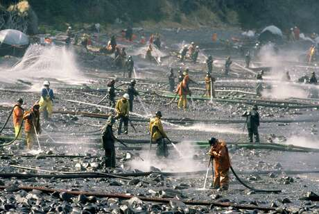 Exxon Valdez oil spill workers use pressure washers to wash oil from the beach at Smith Island on Alaska's Prince William Sound. (Bob Hallinen/Anchorage Daily News/MCT)