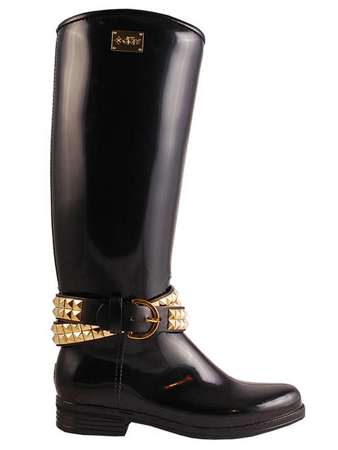 Wrapped in a gold chain, these knee-high boots are as fashionable your sunny-day boots — no one will know the difference. Ashley Belted Solid Black/Gold, $98, Däv. Photo: Contributed Photo