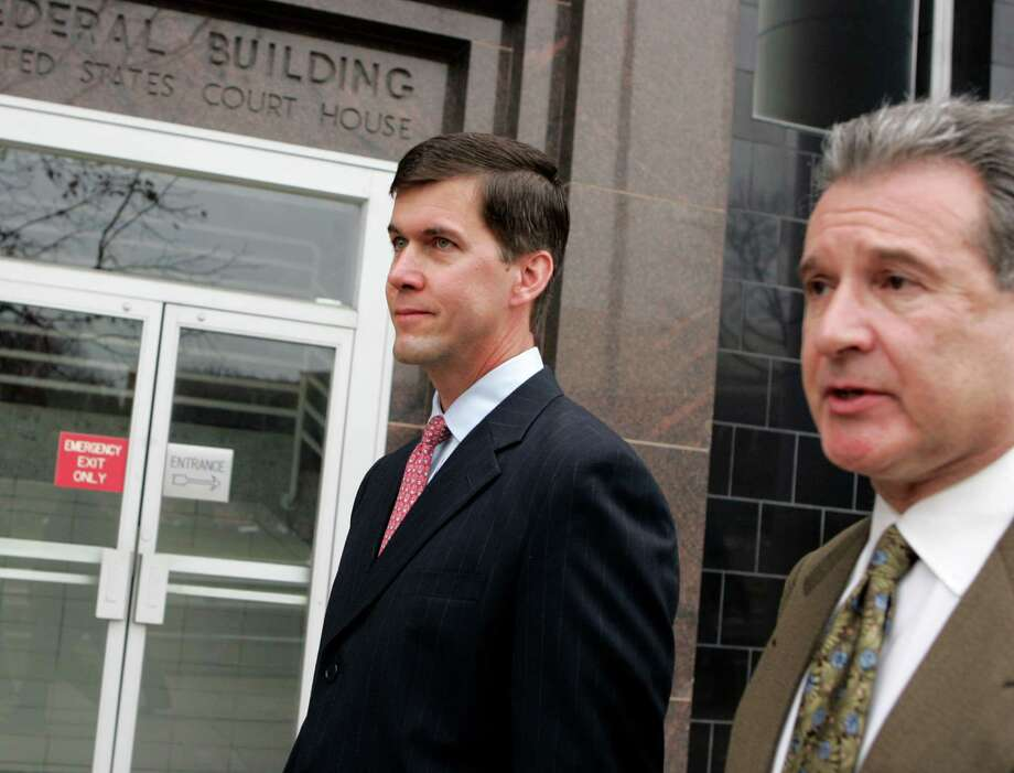 Kevin Howard, left, is the former chief financial officer of Enron's Broadband unit. He pleaded guilty to one count of falsifying records in the Broadband case. He served a 1-year probation. As of 2011, he was serving as vice president and general manager at Kinder Morgan Natural Gas Pipelines. Photo: PAT SULLIVAN, AP / AP