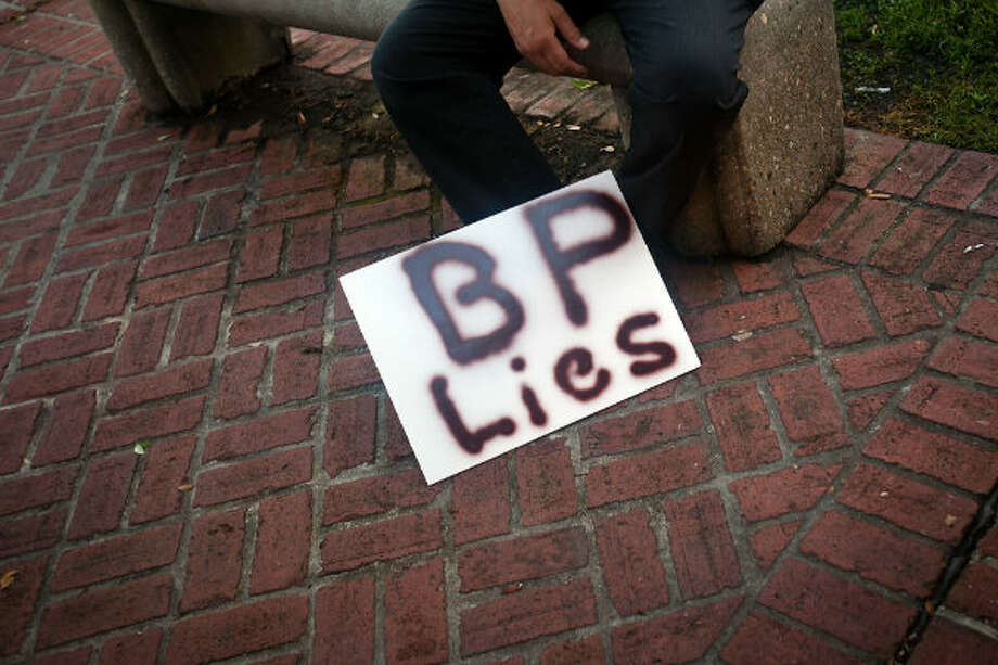 A protester's sign lies outside a meeting where residents were able to get face-to-face time with BP and government officials at one of a series of open houses in New Orleans on June 23, 2010. Photo: Smiley N. Pool / Houston Chronicle