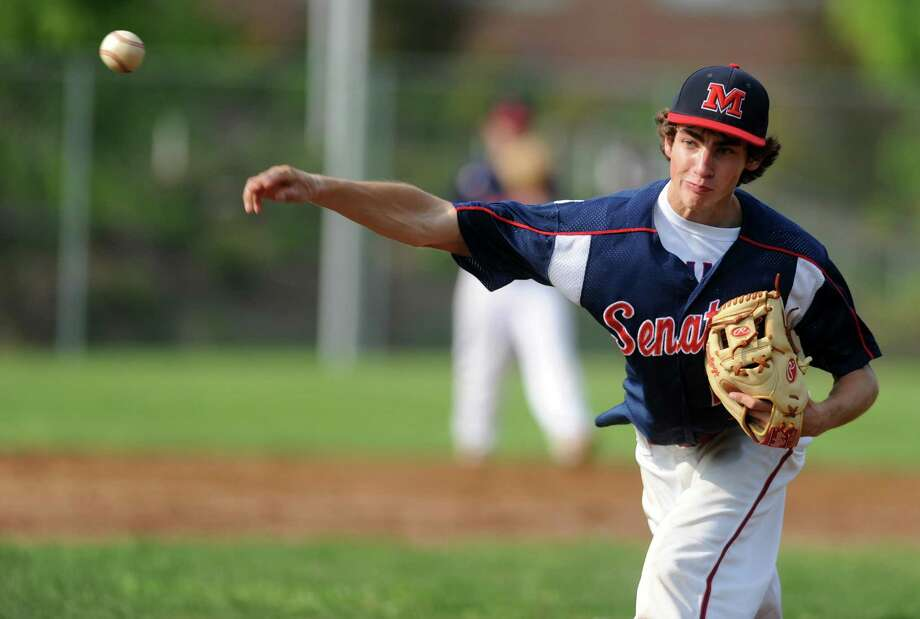 Brien McMahon's Mark Ballard pitches during a baseball game against Staples last season. Photo: Autumn Driscoll / Connecticut Post