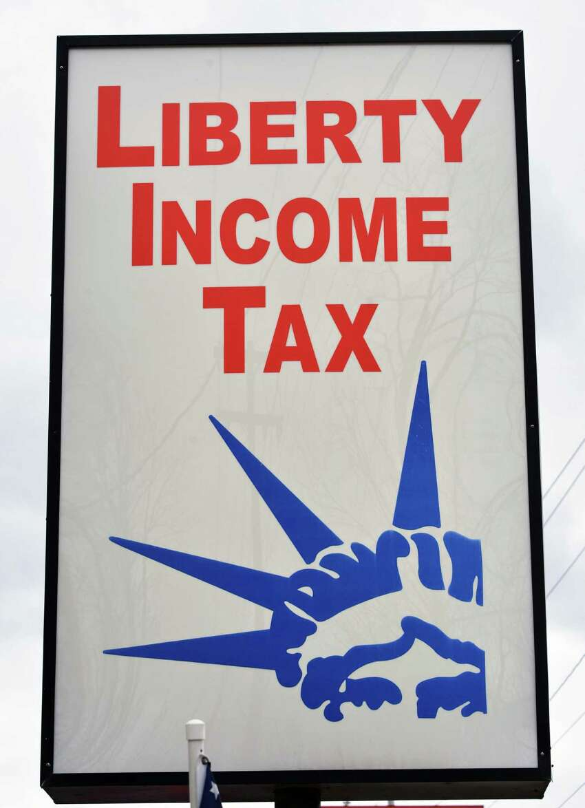 Sign outside the Liberty Income Tax office on Altamont Avenue in Schenectady Thursday March 28, 2013. (John Carl D'Annibale / Times Union)
