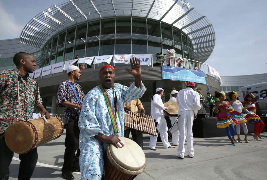 Drummers perform as music and dance groups from various nations that purchase Boeing aircraft perform during a ceremony opening Boeing's new Everett Delivery Center on Wednesday, April 3, 2013 at Paine Field. The facility is where airplane customers will take ownership of their airplanes. Photo: JOSHUA TRUJILLO, SEATTLEPI.COM / SEATTLEPI.COM