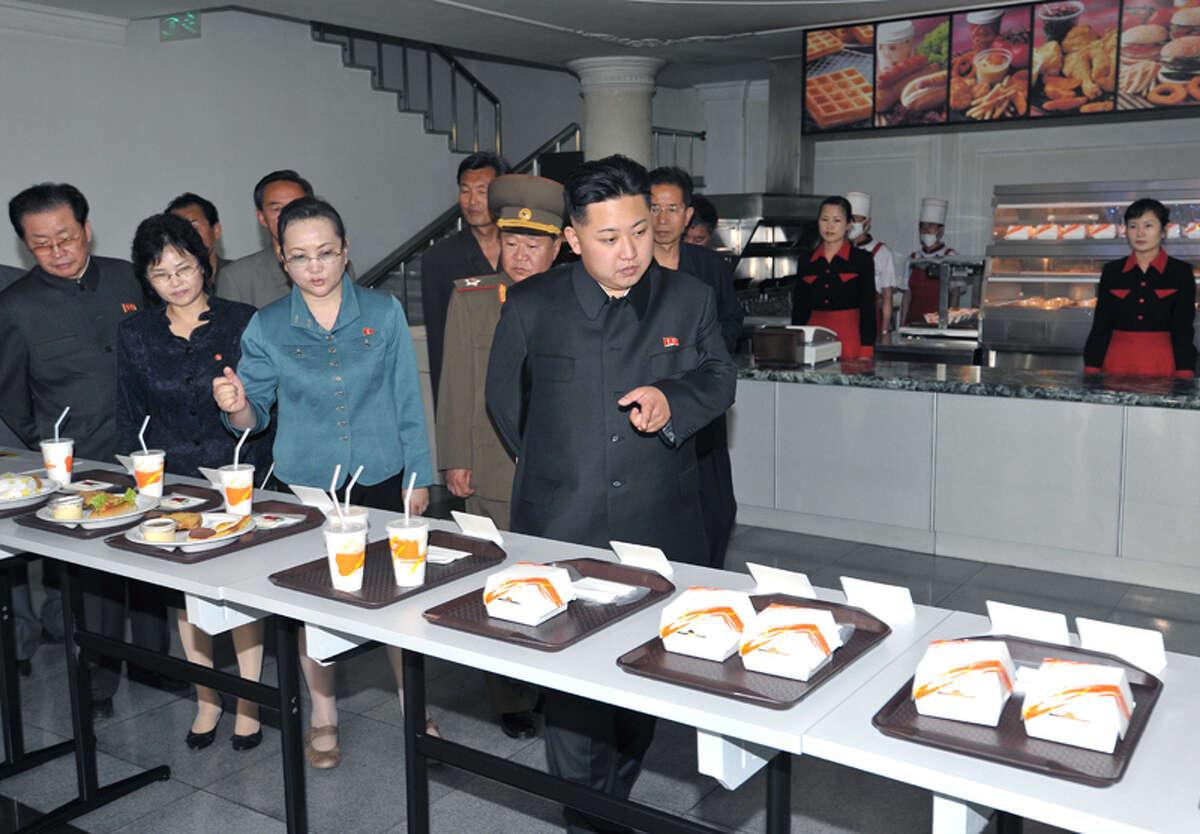 Kim Jong Un looking at fast food.