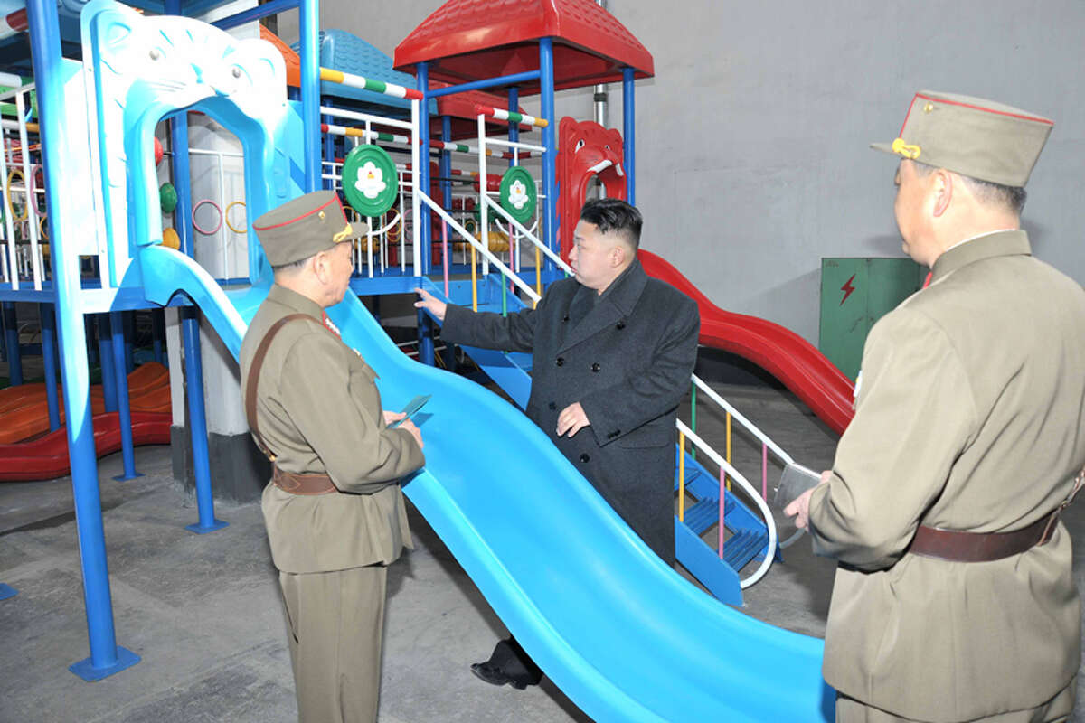 Kim Jong Un looking at a slide.