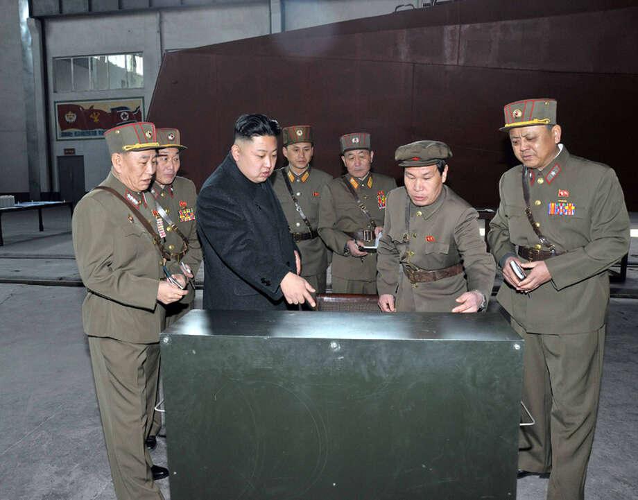 Kim Jong Un looking at stuff. Photo: Uriminzokkiri's Flickr Stream