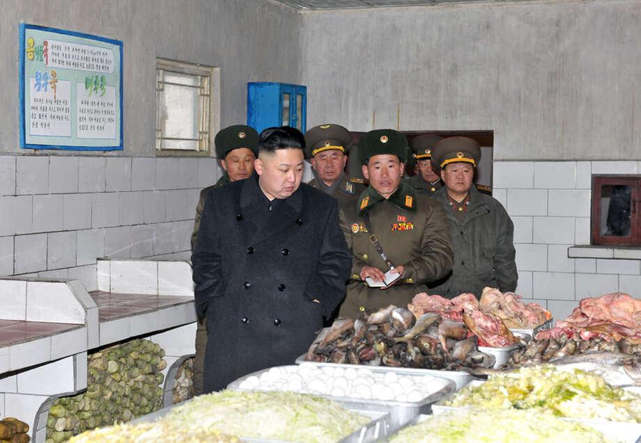 Kim Jong Un looking at animal parts. Photo: Uriminzokkiri's Flickr Stream