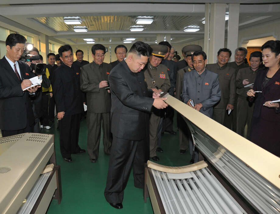 Kim Jong Un looking at a tanning bed. Photo: Uriminzokkiri's Flickr Stream