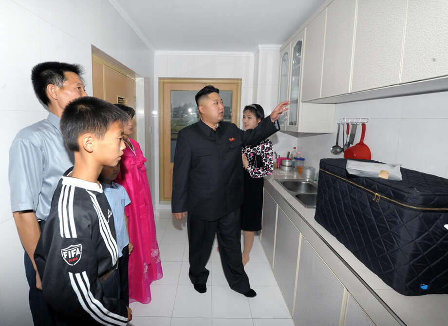 Kim Jong Un looking at kitchen cabinets. Photo: Uriminzokkiri's Flickr Stream