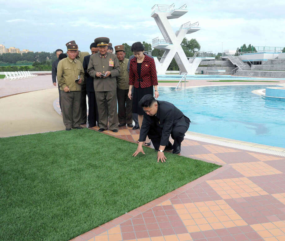 Kim Jong Un looking at fake grass. Photo: Uriminzokkiri's Flickr Stream